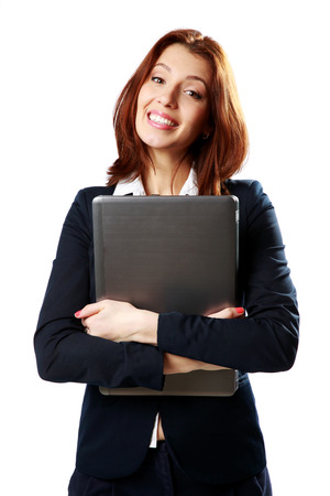 Cheerful businesswoman holding laptop isolated on white background photo