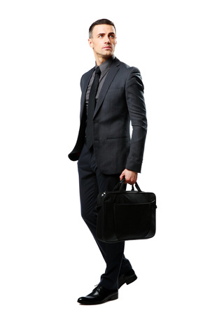 Full-length portrait of a thoughtful businessman with bag isolated on a white background photo