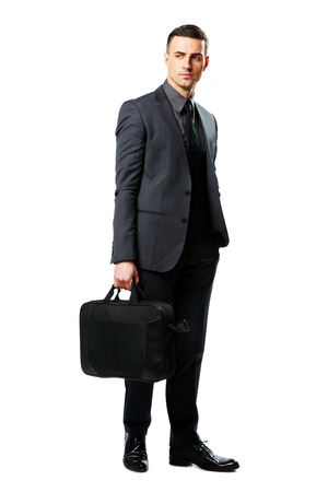 businessman standing: Full-length portrait of a confident businessman with bag isolated on a white background Stock Photo