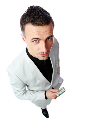 Confident businessman holding US dollars isolated on a white  photo