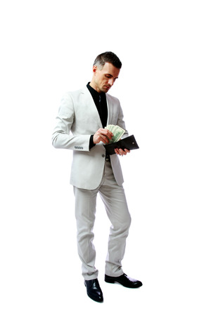 gets: Businessman gets money from the wallet isolated on a white background Stock Photo