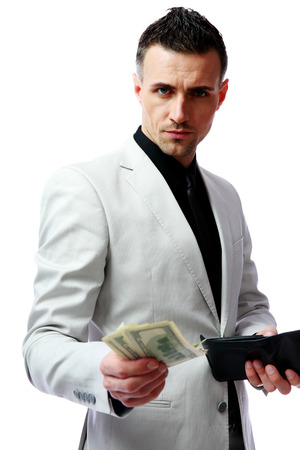 Confident businessman giving US dollars at you photo