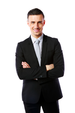 Portrait of a cheerful businessman with arms folded isolated on a white  photo