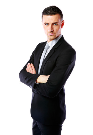 Businessman standing with arms folded over white  photo
