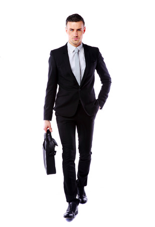 Confident businessman walking with laptop bag isolated on a white background
