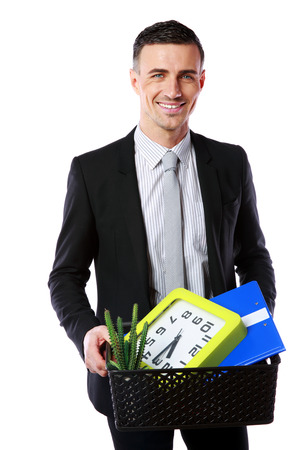 belongings: You are fired! Smiling businessman hold box with personal belongings isolated on white background