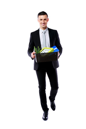 belongings: You are fired! Happy businessman hold box with personal belongings isolated on white background