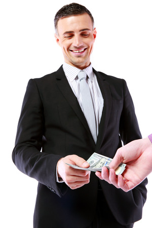 pervert: Businessman giving money isolated on white background Stock Photo