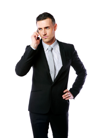 Handsome businessman talking on the phone over white background photo