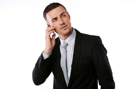 deadpan: Confident businessman talking on the phone over white background