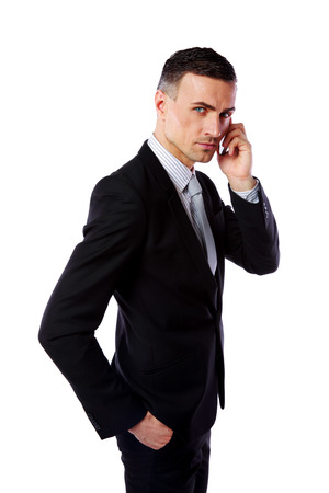 Handsome businessman talking on his mobile phone over white background photo