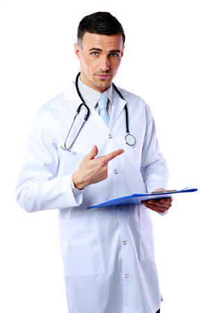 Confident male doctor with clipboard standing and showing gesture over white background