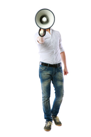 bellowing: Full length portrait of a man with megaphone over white background