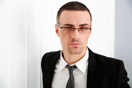 Portrait of a confident businessman in glasses photo