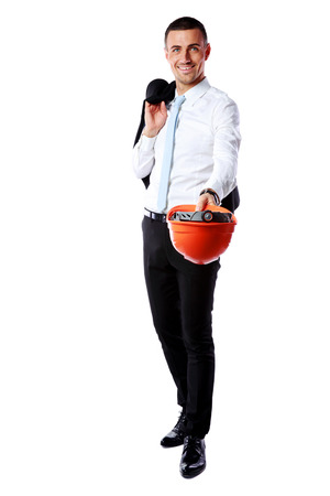 Happy businessman giving helmet at you over white background photo