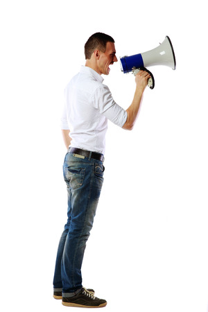 bellowing: Side view of a man screaming on the megaphone over white background