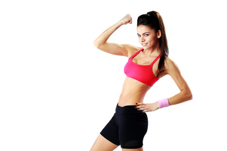 Young happy sport woman showing her biceps over white  photo
