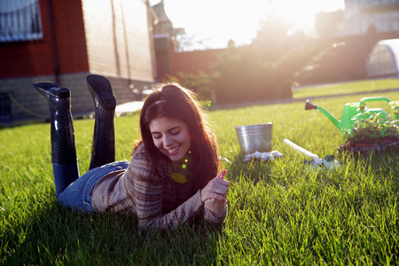 Portrait of a smiling woman lying on green grass Stock Photo - 27907297