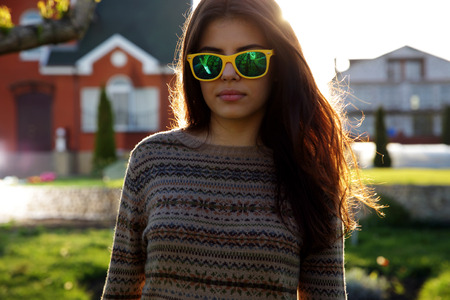lensflare: Portrait of a beautiful woman in fashionable sunglasses