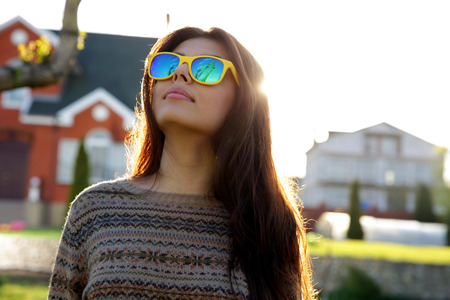 lensflare: Portrait of a pensive woman in trendy sunglasses