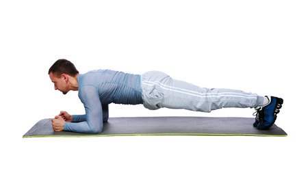 Muscular sportsman practicing yoga on a mat  photo