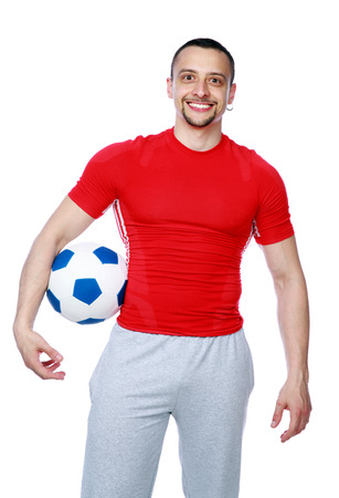 Crazy sportive man holding soccer ball over white background photo