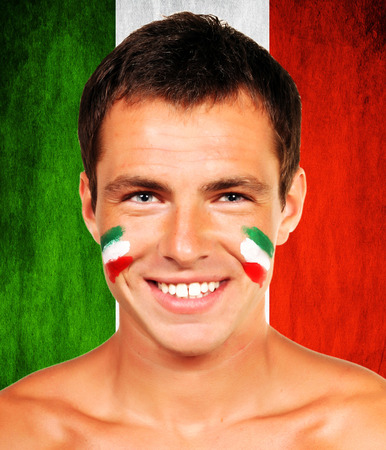 Portrait of an italian soccer fan over italy flag background photo