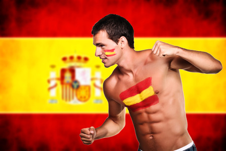 Spanish football fan is ready for fight over spanish flag background photo