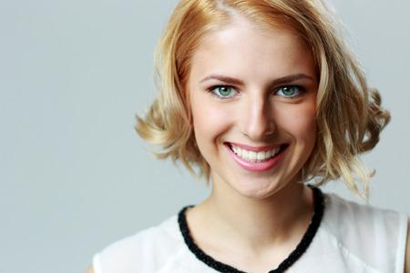 Closeup portrait of a happy smiling woman photo