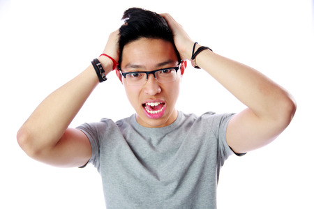 Portrait of a frightened young asian man over white background photo