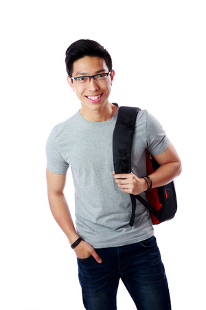 Portrait of a happy student with backpack over white background photo