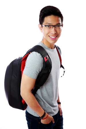 Portrait of a smiling young student with backpack over white background photo