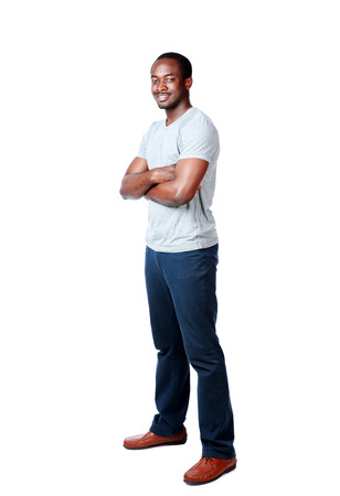 Full length portrait of a cheerful african man over white background