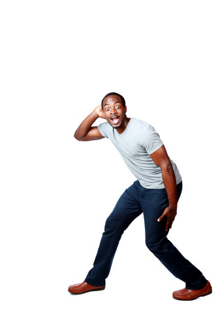 Portrait of a funny african man over white background photo