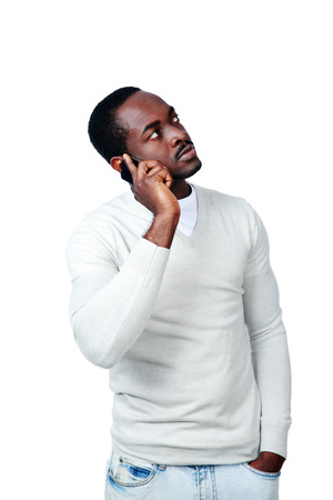 Portrait of african man talking on the phone isolated on a white background Stock Photo