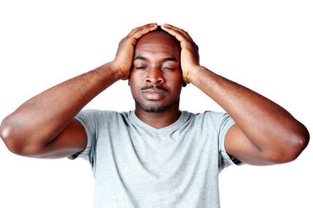 Portrait of African man touching his head over white background photo