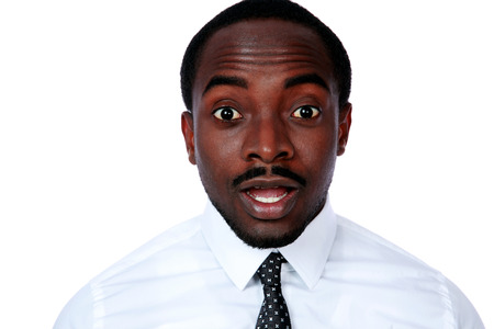 startled: Portrait of surprised african businessman over white background