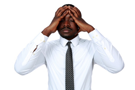 Portrait of African businessman touching his head over white background photo