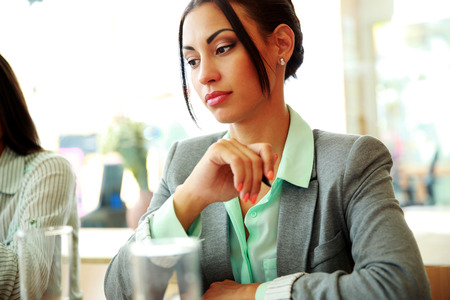 Portrait of a thoughtful businesswoman looking away in office photo