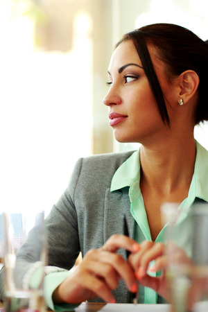 Portrait of a pensive businesswoman looking away in office photo