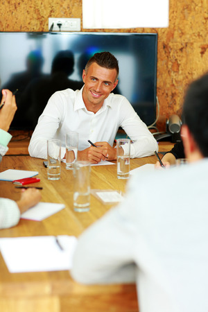 sitted: Happy businessman sitting at the meeting in office Stock Photo