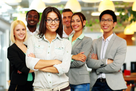 Smiling group of co-workers standing in office Stock Photo