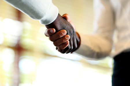 collaborator: Close-up of businessmen shaking hands