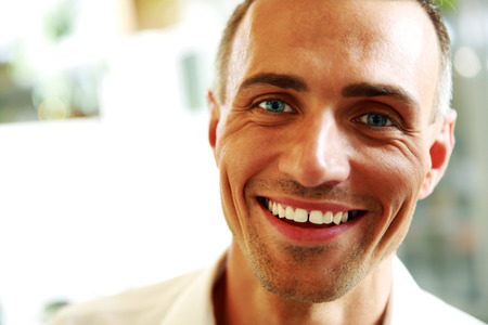 Closeup portrait of a handsome happy man Stock Photo