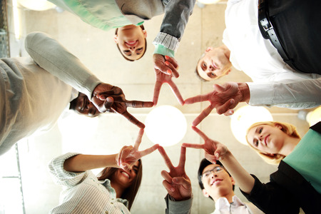business and succcess concept - group of businesspeople showing v-sign together photo