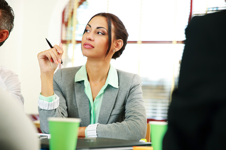 concetrated: Portrait of a businesswoman sitting at the meeting