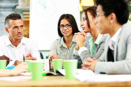 Business people having meeting around table in office