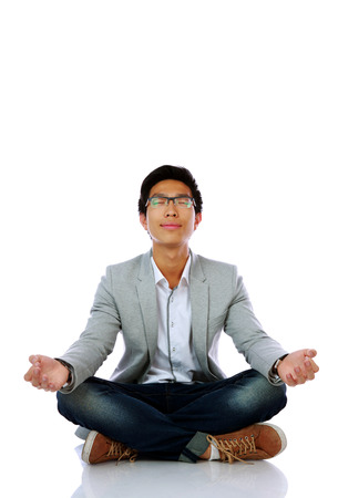 dhyana: Man in casual cloth meditating over white background