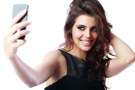 Happy woman taking self picture with smartphone camera photo