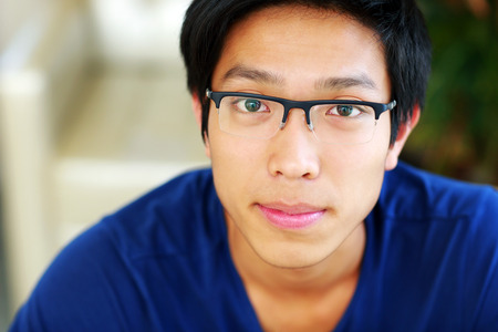 concetrated: Closeup portrait of a serious asian man